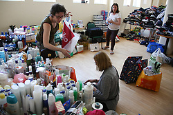 Volunteers help bring supplies of clothing and food to the St Micheal of Asissi church community centre in Notting Hill in the aftermath of the Grenfell Tower blaze<br />