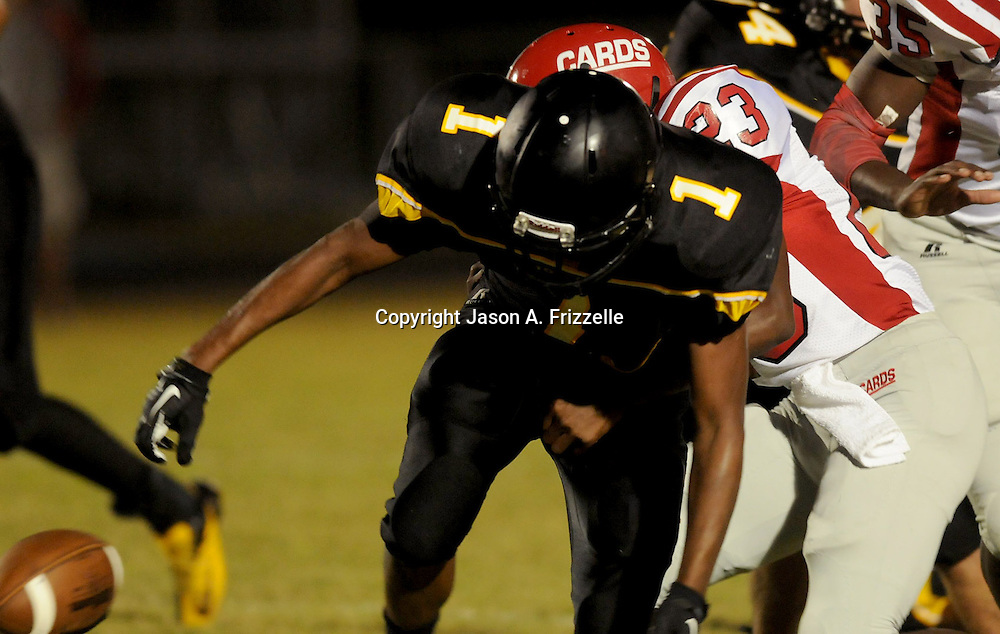 Topsail's Tyrekus Cooper fumbles against Jacksonville's Javelle Turner. (Jason A. Frizzelle)