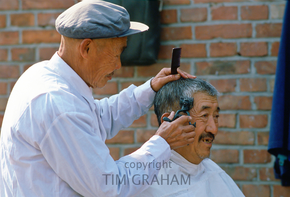 Barber at workoutdoors in Beijing, China