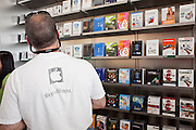 12 JUNE 2009 -- SCOTTSDALE, AZ: A man shops for software in the new Apple Store in Scottsdale, AZ, during its grand opening Friday. The outlet will be Arizona's largest Apple Store, occupying nearly 10,000 square feet in the Outdoor Lifestyle Center in the Scottsdale Quarter. The store, the fifth in the Phoenix area, uses a radically different design from other Apple Stores in some respects. Ceilings in the building are approximately 20 feet high, and lined with a 75-foot long skylight, reducing dependence on artificial lighting. Aiding the skylight is an all-glass front and rear, permitting visitors to see directly through the store. More than one thousand people lined to get into the store during the grand opening. Photo by Jack Kurtz