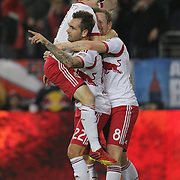 Jonny Steele, (middle) New York Red Bulls, is congratulated by team mates Dax McCarty, (top), and David Carney after scoring his sides fifth goal during the New York Red Bulls V Chicago Fire, Major League Soccer regular season match at Red Bull Arena, Harrison, New Jersey. USA. 27th October 2013. Photo Tim Clayton