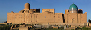 Panoramic view of Chor-Bakr, 16th century, Bukhara, Uzbekistan, pictured on July 10, 2010 in the afternoon. The memorial complex of Chor-Bakr, located around the tomb of Abu-Bakr-Said (died 970 AD), and his three brothers, who were descendants of the Prophet Muhammad, was originally commissioned by Abdullah Khan in 1559-63, and further developed by Adullahan II in 1858. Regarded as a Holy site it contains a Mosque, Khanagha and Madrasah and is plain in style. Bukhara, a city on the Silk Route is about 2500 years old. Its long history is displayed both through the impressive monuments and the overall town planning and architecture. Picture by Manuel Cohen.