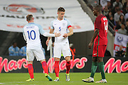 England forward, Wayne Rooney (10) being subbed and England defender, Gary Cahill (05) becoming captain during the Friendly International match between England and Portugal at Wembley Stadium, London, England on 2 June 2016. Photo by Matthew Redman.