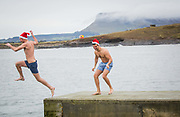 Annual Christmas Day Swim in aid of Sligo Cancer Support Centre at Rosses Point, Co Sligo.<br /> Photo: James Connolly<br /> 25DEC17