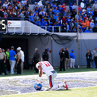 Lauren Wood | Buy at photos.djournal.com<br /> Ole Miss tight end Evan Engram bows his head in the end zone before the start of Saturday's game at Memphis.