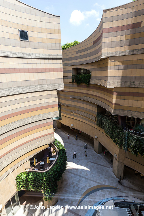 "Lacking green space in central Osaka, the upper layers of Namba Parks - a vast shopping complex - have been turned into a topsy-turvy rooftop garden. An innovative and curvaceous ""canyon"" cuts down into the lower floors giving natural light to stores downstairs."