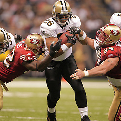 2008 September 28: New Orleans Saints running back Deuce McAllister (26) splits San Francisco defenders Aubrayo Franklin (92) and Justin Smith (94) on a run during the NFL week four game between the San Francisco 49ers and the New Orleans Saints at the Louisiana Superdome in New Orleans, LA.