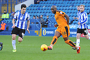 Fernando Forestieri of Sheffield Wednesday,Wolverhampton Wanderers striker Benik Afobe  during the Sky Bet Championship match between Sheffield Wednesday and Wolverhampton Wanderers at Hillsborough, Sheffield, England on 20 December 2015. Photo by Ian Lyall.