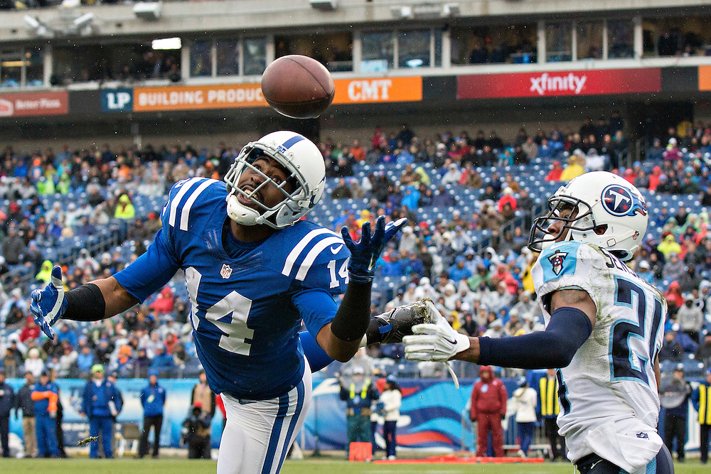 NASHVILLE, TN - DECEMBER 28:  Hakeem Hicks #14 of the Indianapolis Colts misses a touchdown pass while being covered by Coty Sensabaugh #24 of the Tennessee Titans at LP Field on December 28, 2014 in Nashville, Tennessee.  The Colts defeated the Titans 27-10.  (Photo by Wesley Hitt/Getty Images) *** Local Caption *** Hakeem Hicks; Coty Sensabaugh
