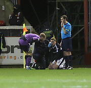 Dundee physio Gerry Doherty treats Dundee&rsquo;s Kevin Holt after his head was cut by Aberdeen&rsquo;s Shaleum Logan's high boot - Aberdeen v Dundee, Ladbrokes Premiership at Pittodrie<br /> <br />  - &copy; David Young - www.davidyoungphoto.co.uk - email: davidyoungphoto@gmail.com