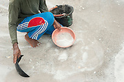 A miner, Darman (53 years) sifts sand in search of tin. He has been a miner since 22 years. He earns 6 Euros a day.  Most mines are exploited illegally and accidents occur often. Tin mine on the road to Pemali. Bangka Island (Indonesia) is devastated by illegal tin mines. The demand for tin has increased due to its use in smart phones and tablets.<br /> <br /> Un mineur, Darman (53 ans) tamise du sable à la recherche de l'étain. Il a été UN mineur depuis 22 ans et il gagne 6 euros par jour. La plupart des mines sont exploitées illégalement et les accidents se produisent souvent. Mine d'étain sur la route de Pemali. L'île de Bangka (Indonésie) est dévastée par des mines d'étain sauvages. La demande de l'étain a explosé à cause de son utilisation dans les smartphones et tablettes.