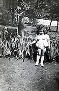 little girl posing with flowers in the garden France vintage