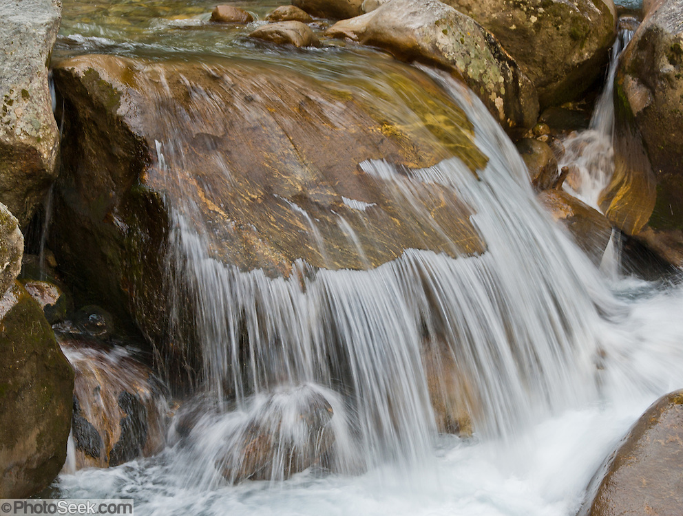 A creek flows over eroded stone in Nepal