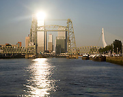 Early morning sunshine on the River Maas and de Hef railway bridge, Koningshaven,  Rotterdam, Netherlands