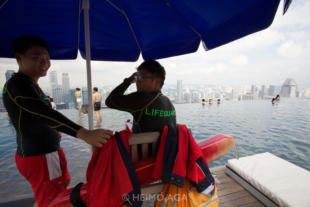 Singapore. Marina Bay Sands Hotel. The Pool offers a breathtaking view over Singapore..Life guards.