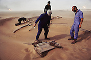 Members of the British Explosive Ordinance Disposal Team searching for mines and weapons caches in the Manageesh Oil Fields, near the Saudi border. More than 700 wells were set ablaze by retreating Iraqi troops creating the largest man-made environmental disaster in history.