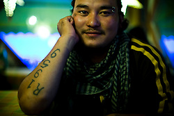 "A second generation Tibetan exile who was born in India and has never been to Tibet shows his tatoo with ""1959"", a yaer of  Dalai Lama's exile from Tibet to India after a failed uprising against Chinese rule in McLeod Ganj, Dharamsala, India, May 30, 2009."