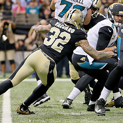 Dec 27, 2015; New Orleans, LA, USA; New Orleans Saints strong safety Kenny Vaccaro (32) sacks Jacksonville Jaguars quarterback Blake Bortles (5) during the second quarter of a game at the Mercedes-Benz Superdome. Mandatory Credit: Derick E. Hingle-USA TODAY Sports