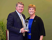 ACC Commissioner John D. Swofford presents former Duke coach Debbie Leonard with her Women's ACC Legends Award at the 2011 ACC Legends Banquette held at the Terrace Greensboro Coliseum Complex  in Greensboro, North Carolina.  (Photo by Mark W. Sutton)