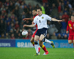 CARDIFF, WALES - Friday, October 12, 2012: Wales' Craig Davies in action against Scotland's Gary Caldwell during the Brazil 2014 FIFA World Cup Qualifying Group A match at the Cardiff City Stadium. (Pic by David Rawcliffe/Propaganda)