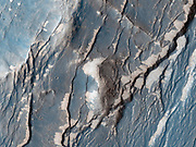 The Claritas Fossae region is characterised by systems of 'graben' running mainly north-west to south-east. A graben forms when a block of the planet's crust drops down between two faults, due to extension, or pulling, of the crust. MRO.