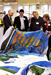 © Licensed to London News Pictures. 28/02/2012. Don Cameron (left) shows nylon balloon fabric being sewn in the Cameron's balloon factory.  Cameron Balloons factory in Bedminster, Bristol, manufactures hot air balloons for clients around the world.  They are seeking sponsorship for this year's Bristol International Balloon Fiesta which takes place in August..Photo credit : Simon Chapman/LNP