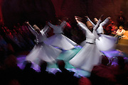 Members of the Sufi sect, originally founded in Afghanistan, become trance like in Meditation as Whirling Dervishes, Sultanahmet.This is an evening performance for the benefit of tourists.