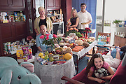 "(MODEL RELEASED IMAGE) The Sobczynscy family in the main room of their apartment in Konstancin-Jeziorna, Poland, outside Warsaw; with a week's worth of food. Marzena Sobczynska, and Hubert Sobczynski stand in the rear; with Marzena's parents; Jan Boimski, and Anna Boimska; to their right and their daughter Klaudia on the couch. (Polish surnames are gender-based and can change when speaking of the family as a whole. ""Sobscynscy"" is plural). The Sobczynscy family is one of the thirty families featured in the book Hungry Planet: What the World Eats (p. 246)."