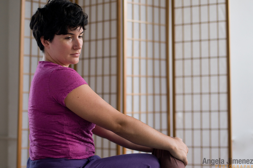 Bodyworker Sara Roer is photographed in the studio at The Brooklyn Arts Exchange, performing Thai massage on a subject. ..Photographed by Angela Jimenez on August 9, 2011. .www.angelajimenezphotography.com