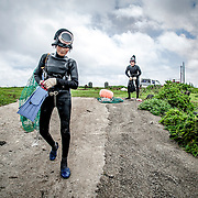 Women divers, known as haenyeo, prepare to dive for shellfish on Udo, a small islet off of Jeju Island, South Korea.