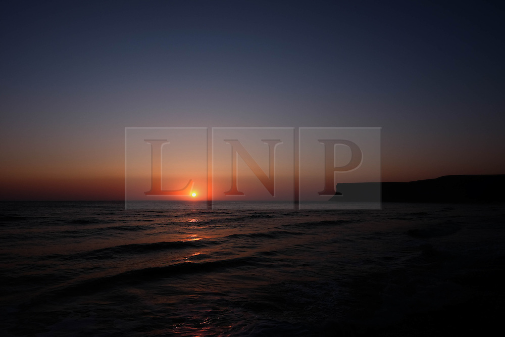 © Licensed to London News Pictures. <br /> 09/05/2016. <br /> Saltburn by the Sea, UK.  <br /> <br /> The sun rises over the coastline at Saltburn by the Sea in North Yorkshire. After the warmest day of the year yesterday temperatures are due to drop slowly over the rest of the week.<br /> <br /> Photo credit: Ian Forsyth/LNP