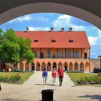 Former Bishop&rsquo;s Palace at Castle of Eger in Eger, Hungary <br /> After paying a small admission at the castle ticket office, you pass through an arch and see the former Bishop&rsquo;s Palace. P&uuml;sp&ouml;k H&aacute;z was built in 1470 during the reign of King Matthias. The simple yet elegant Gothic design was commissioned by Bishop J&aacute;nos Bekensloer. The building now houses the Istv&aacute;n Dob&oacute; Castle Museum. Inside you will learn the castle&rsquo;s history plus cringe at the displays of Medieval punishment. An adjacent structure serves as the Eger Art Gallery displaying the works of Hungarian and other European masters.