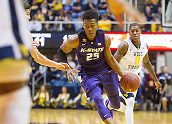 Feb 11, 2017; Morgantown, WV, USA; Kansas State Wildcats forward Wesley Iwundu (25) drives down the lane during the first half against the West Virginia Mountaineers at WVU Coliseum. Mandatory Credit: Ben Queen-USA TODAY Sports