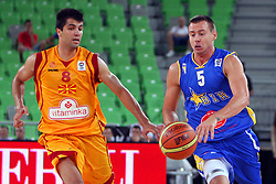 Aleksej Nesovic of BiH and Vojdan Stojanovski of Macedonia at friendly match between Macedonia and BIH for Adecco Cup 2011 as part of exhibition games before European Championship Lithuania on August 6, 2011, in SRC Stozice, Ljubljana, Slovenia. (Photo by Urban Urbanc / Sportida)