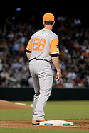 PHOENIX, AZ - AUGUST 27:  Buster Posey #28 of the San Francisco Giants wearing a nickname-bearing jersey stands at first base in the MLB game against the Arizona Diamondbacks at Chase Field on August 27, 2017 in Phoenix, Arizona.  (Photo by Jennifer Stewart/Getty Images)