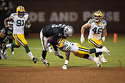 Oakland Raiders quarterback EJ Manuel (3) is hit by diving Green Bay Packers rookie defensive back Raven Greene (36), knocking the ball loose and causing a fumble recovered by the Packers at the Raiders 43 yard line in the fourth quarter during the 2018 NFL preseason week 3 football game against the Green Bay Packers on Friday, Aug. 24, 2018 in Oakland, Calif. The Raiders won the game 13-6. (©Paul Anthony Spinelli)