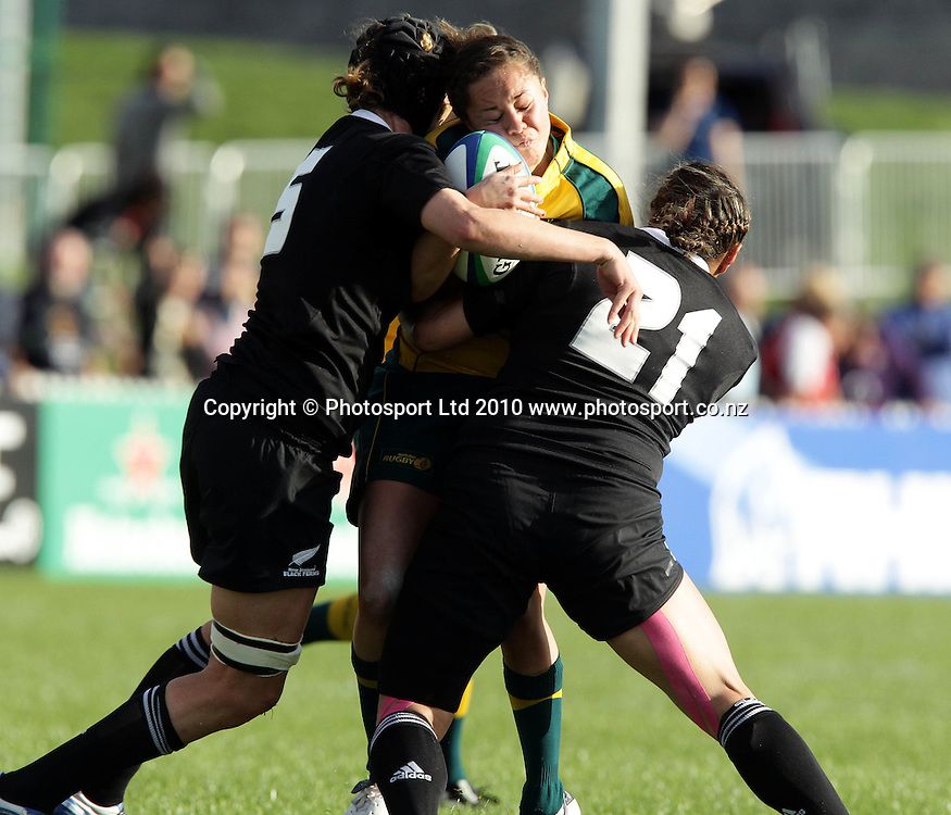 Cobie Jane Morgan tackled by Victoria Heighway and Trisha Hina<br />Women's rugby world Cup rugby union test match, New Zealand Black Ferns v Australia, Surrey Sports Park, England. <br />Tuesday 24 August 2010. Photo: Paul Seiser/PHOTOSPORT
