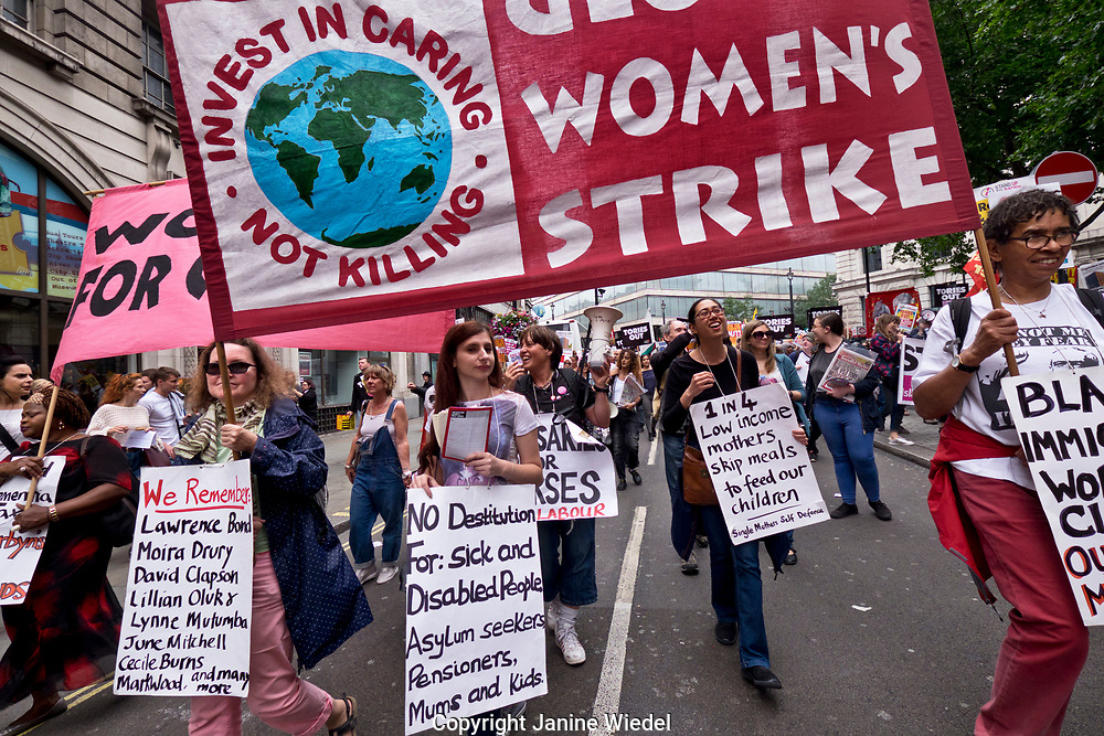 Global Womens strike join thousands on march through central London on Anti-austerity and get rid of Theresea May and conservative government demonstration July 1 2017