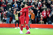 Liverpool forward Mohamed Salah (11) celebrates his goal 4-3 with Liverpool forward Roberto Firmino (9) during the Champions League match between Liverpool and FC Red Bull at Anfield, Liverpool, England on 2 October 2019.