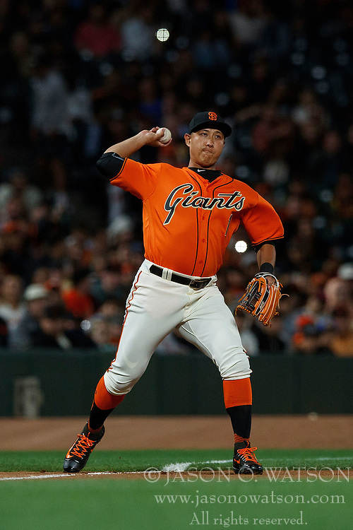 SAN FRANCISCO, CA - JULY 07: Jae-Gyun Hwang #1 of the San Francisco Giants throws to first base after fielding a ground ball against the Miami Marlins during the seventh inning at AT&T Park on July 7, 2017 in San Francisco, California. The Miami Marlins defeated the San Francisco Giants 6-1. (Photo by Jason O. Watson/Getty Images) *** Local Caption *** Jae-Gyun Hwang