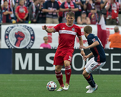 June 17, 2017 - Foxborough, Massachusetts, USA - Foxborough, Massachusetts - June 17, 2017: First half action. In a Major League Soccer (MLS) match, New England Revolution (blue/white) vs Chicago Fire (red), at Gillette Stadium. (Credit Image: © Andrew Katsampes/ISIPhotos via ZUMA Wire)