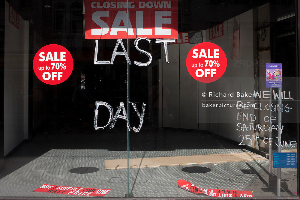 The window of a now vacant shop window, closed after its last day of trading in Oxford Street, London, UK.