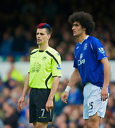 LIVERPOOL, ENGLAND - Sunday, April 5, 2009: The funny haircut club... Everton's Marouane Fellaini and Wigan Athletic's Paul Scharner during the Premiership match at Goodison Park. (Pic by David Rawcliffe/Propaganda)