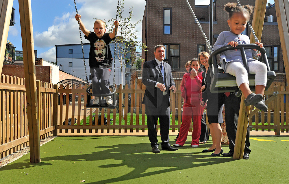 SOUTH BERMONDSEY, LONDON:  (L-R) Alfie Warren,9 and Eden, Tingling, 2,  play on the swings.  Ed Balls, Labour Leadership candidate joins shadow housing minister John Healey and  shadow work and pensions secretary Yvette Cooper  during a visit to a housing development, The Falcon Works development, in central London on 31 August 2010. STEPHEN SIMPSON..