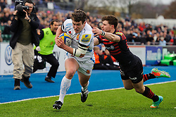 Exeter Outside Centre (#13) Ian Whitten avoids a tackle from Saracens Full Back (#15) Ben Ransom to score a try - Photo mandatory by-line: Rogan Thomson/JMP - Tel: 07966 386802 - 23/02/2014 - SPORT - RUGBY UNION - Allianz Park, London - Saracens v Exeter Chiefs - Aviva Premiership.