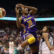 Nneka Ogwumike, Los Angeles Sparks, (wearing face mask), is fouled by Alex Bentley, Connecticut Sun, as she drives o the basket during the Connecticut Sun Vs Los Angeles Sparks WNBA regular season game at Mohegan Sun Arena, Uncasville, Connecticut, USA. 3rd July 2014. Photo Tim Clayton