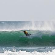 Surfers at Playa Maderas, outside of San Juan del Sur, Nicaragua.  (Photo/William Byrne Drumm)