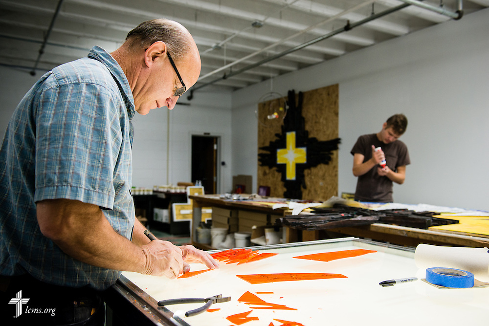 Mark Anschutz, managing artist at The Center for Liturgical Art, and student Austin Romine work on stained glass Monday, July 28, 2014, at Concordia University, Nebraska, in Seward, Neb. LCMS Communications/Erik M. Lunsford