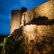 The rocky foundation and walls of Harlech Castle in Harlech, Gwynedd, on the northwest coast of Wales next to the Irish Sea. The castle was built by Edward I in the closing decades of the 13th century as one of several castles designed to consolidate his conquest of Wales.