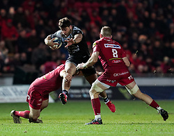 Toulon's Facundo Isa is tackled by Scarlets' Ken Owens<br /> <br /> Photographer Simon King/Replay Images<br /> <br /> European Rugby Champions Cup Round 6 - Scarlets v Toulon - Saturday 20th January 2018 - Parc Y Scarlets - Llanelli<br /> <br /> World Copyright © Replay Images . All rights reserved. info@replayimages.co.uk - http://replayimages.co.uk